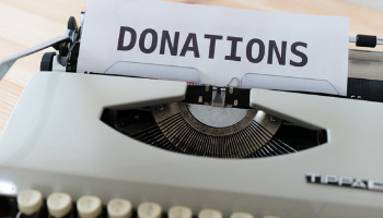 Donations-Button-Navigation-to-Fundraising-Page-Typewriter-with-work-donations-on-page