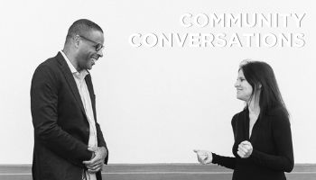 Bill Johnson and Kate Delany Collingswood Together talking with text Community Conversations black and white photo